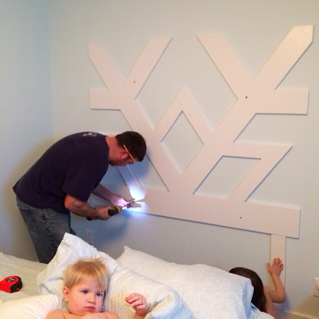 Exciting. The #Frozen Snowflake headboard is being secured to the studs with 2 lil helpers #diy #diyfarmproject #disney #bedroom #home #decorate #design #roomspiration #roomstyle #pastelroom