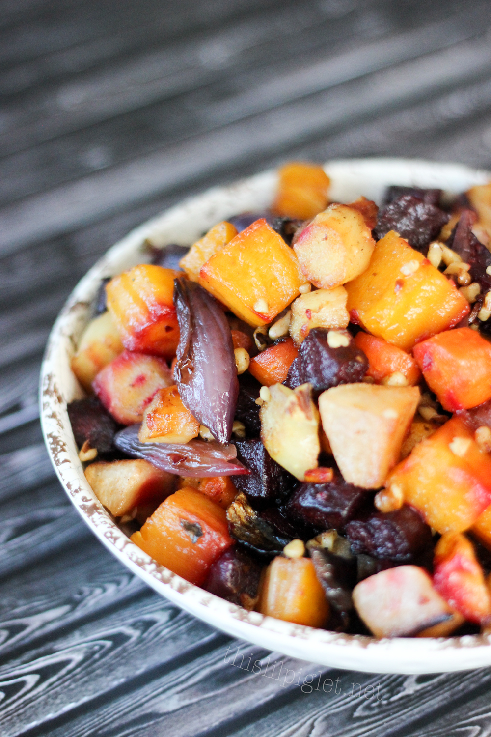 Cranberry Pecan Hasselback Sweet Potato Bake - This Lil Piglet