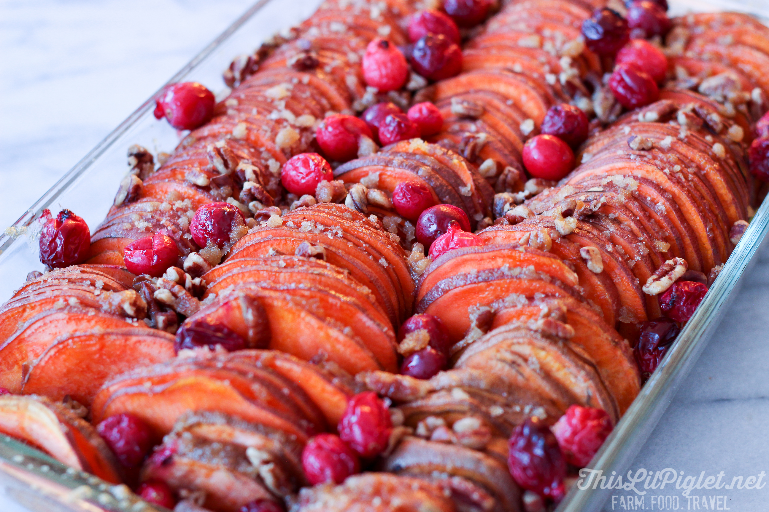 Hasselback Sweet Potato Bake with Cranberries // thislilpiglet.net