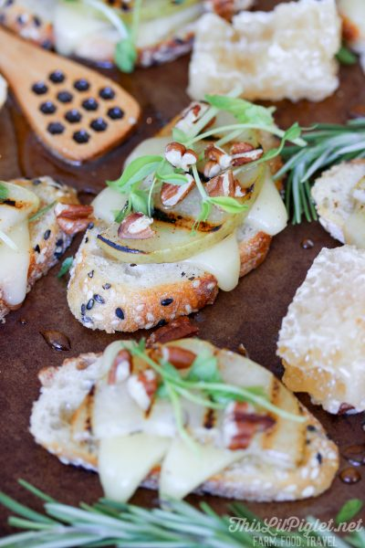 Grilled Pear Crostini with Cheese and Honey Pecan Drizzle
