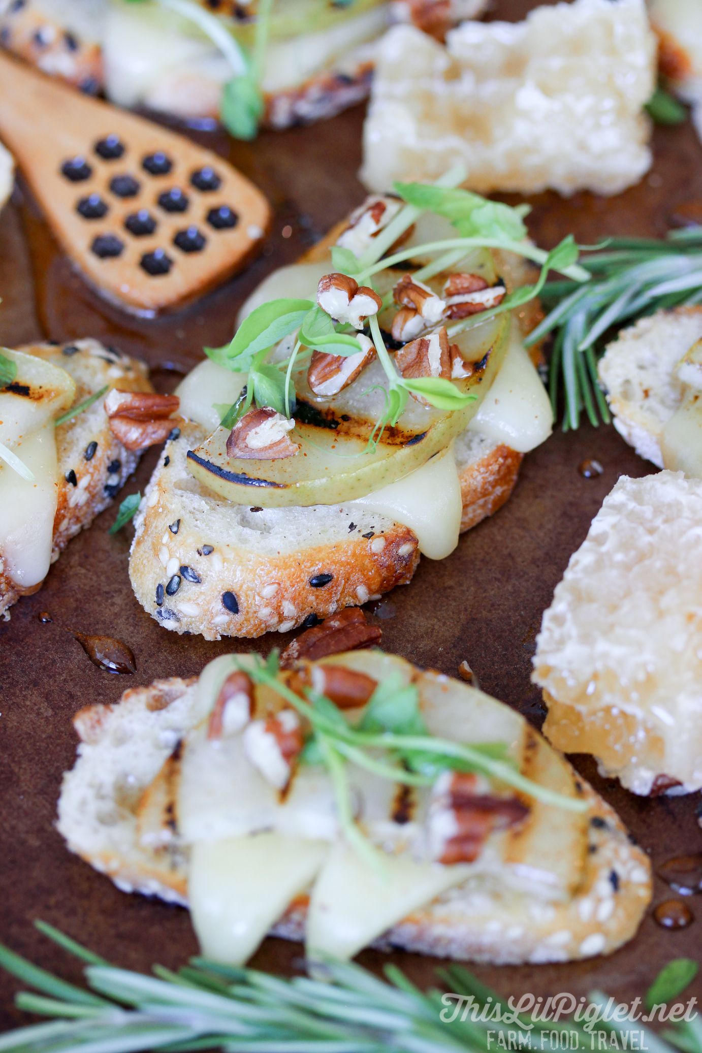 Grilled Pear Cheese Crostini with Honey Pecan Drizzle // thislilpiglet.net