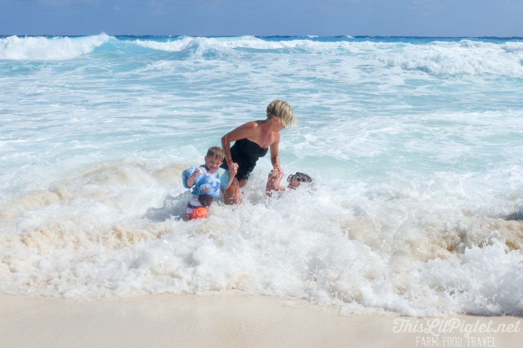 Family Vacations for All Ages at Cancun Paradise Club Resort: Things to Do - White Sand Beach Jumping Waves with Family // thislilpiglet.net